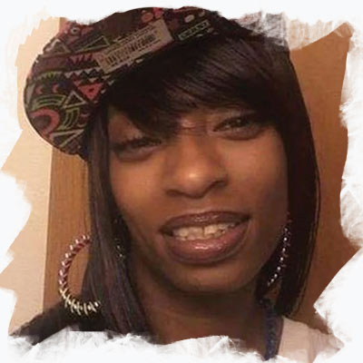 Charleena Lyles real photograph. She's wearing a cap and hoop earrings.