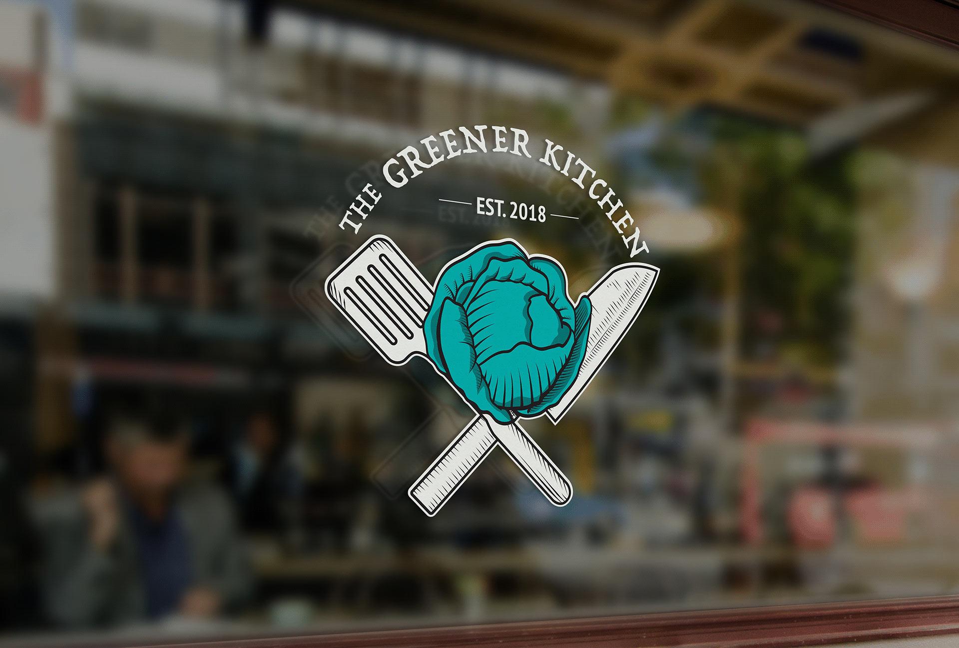 """The Greener Kitchen"" logo at restaurant front."